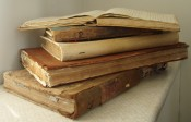 Photograph of several old volumes from the archive